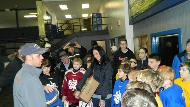 Hockey Team Becomes Family For The Band Aid King