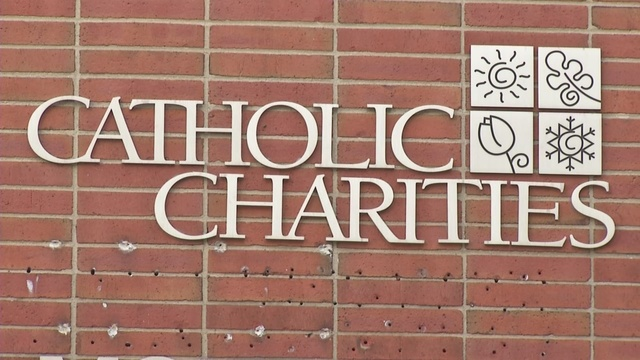 Catholic Charities staff members urge Bishop Malone to reverse foster care, adoption decision