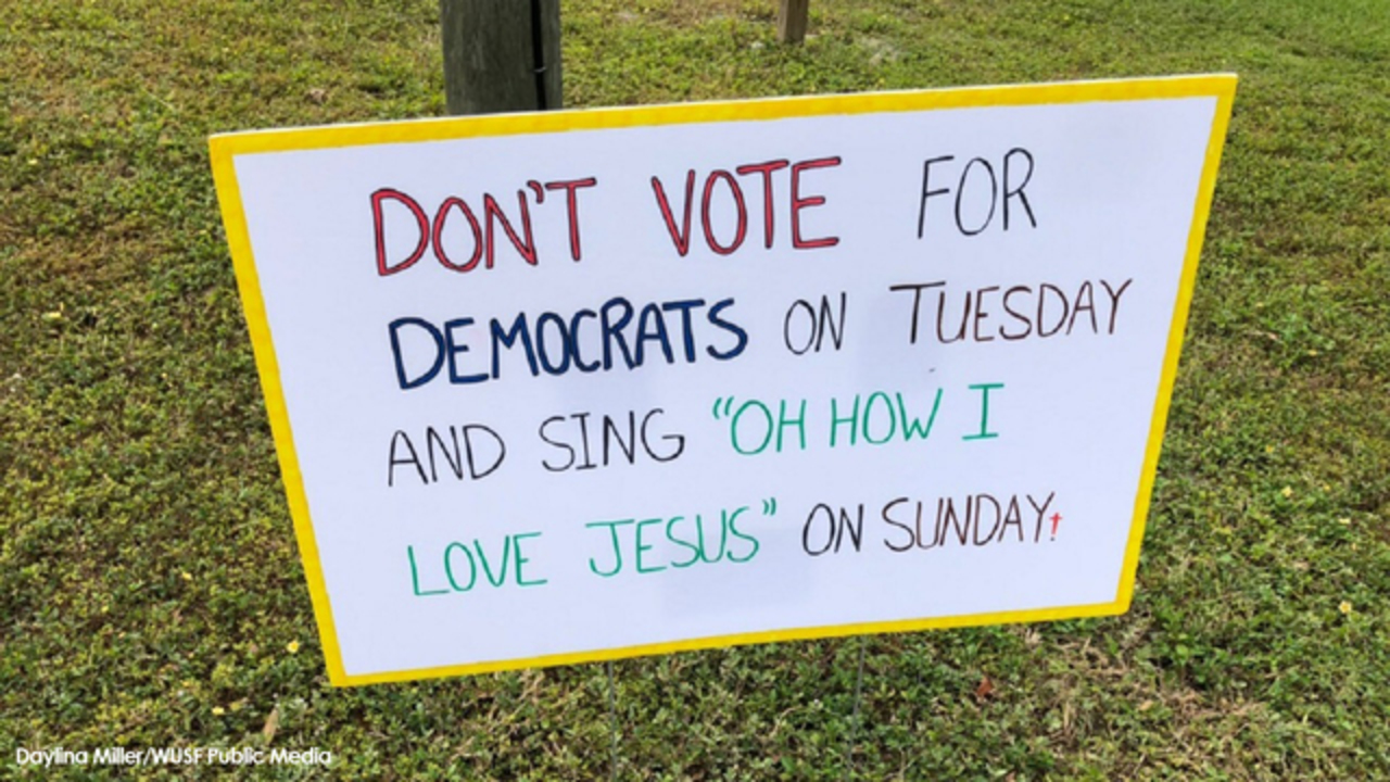 Pastor's sign outside polling place angers voters