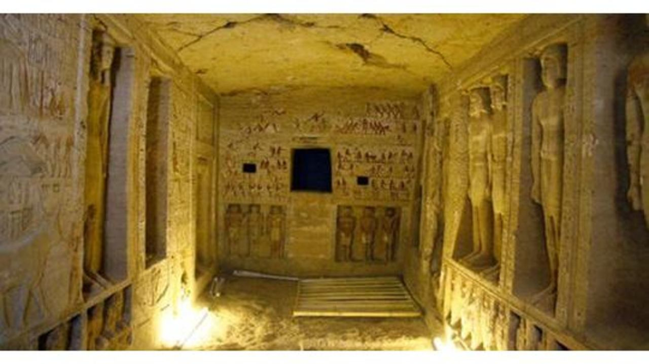 egyptian tomb discovered  statues and hieroglyphics